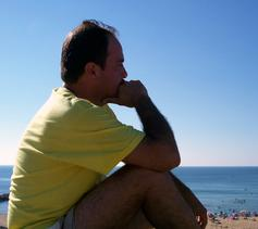 man thinking over the beach